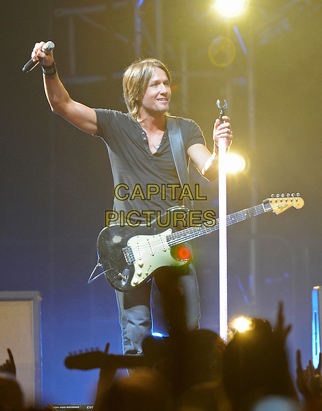 Keith Urban.2011 Keith Urban in concert at Bridgestone Arena, Nashville, Tennessee, USA..August 6th, 2011.stage concert liv gig performance music full length jeans denim black t-shirt guitar  hand arm.CAP/ADM.©AdMedia/Capital Pictures.