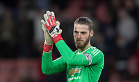 Goalkeeper David De Gea of Man Utd applauds the supporters after being named captain for the first time ever as a Man Utd player during the Premier League match between Bournemouth and Manchester United at the Goldsands Stadium, Bournemouth, England on 18 April 2018. Photo by Andy Rowland.