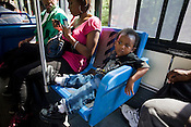 Three-year-old Lakei Web rides the number seven D.A.T.A. bus with his parents Kerria Massenburg and Cliff on the way to The Streets at Southpoint mall.