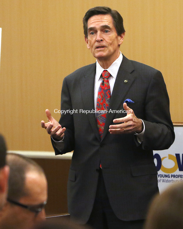 WATERBURY CT. 22 January 2016-012216SV03-James C. Smith, chairman and CEO of Webster Bank, speaks during the Young Professionals of Waterbury Region meeting in Waterbury Friday. The YPOWR meeting was  a Waterbury Regional Chamber event.<br /> Steven Valenti Republican-American