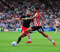 Lincoln City's Bruno Andrade vies for possession with Swindon Town's Dion Conroy<br /> <br /> Photographer Andrew Vaughan/CameraSport<br /> <br /> The EFL Sky Bet League Two - Lincoln City v Swindon Town - Saturday August 11th 2018 - Sincil Bank - Lincoln<br /> <br /> World Copyright &copy; 2018 CameraSport. All rights reserved. 43 Linden Ave. Countesthorpe. Leicester. England. LE8 5PG - Tel: +44 (0) 116 277 4147 - admin@camerasport.com - www.camerasport.com