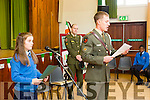 Defence Force Lt Denis Sheahan and Paula Clifford with  Gunner Mark Coffey read from the  proclamation  to  commemorate the 100 year anniversary at Presentation  Primary School on Tuesday