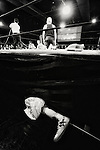 A wrestler's prosthetic limb lies by the side of a ring while he battles in a bout  at Doglegs, an event for wrestlers with physical and mental challenges in Tokyo, Japan.