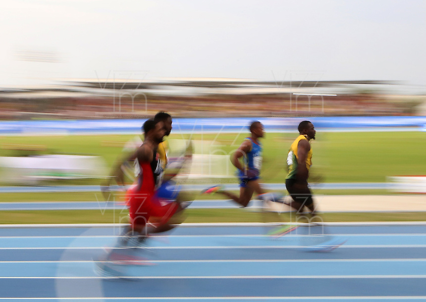 BARRANQUILLA - COLOMBIA, 29-07-2018: Aspecto de la prueba 100 Metros Planos Hombres, en el Estadio de Atletismo, como parte de los Juegos Centroamericanos y del Caribe Barranquilla 2018. / Appearance of the 100 Meters Flat Men test, at the Athletics Stadium, as a part of the Central American and Caribbean Sports Games Barranquilla 2018. Photo: VizzorImage / Cont.