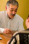 Hispanic man playing cards, close-up