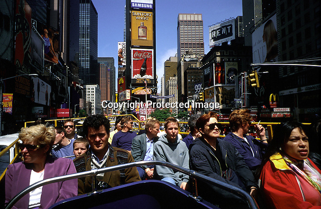 A tourist bus full of people passing trough Times Square on April 17, 1997 in New York City, New York, USA. Times Square has been totally renovated and upgraded and most sex shops and thieves have dissapeared.  Theme restaurants and financial companies has moved in..(Photo: Per-Anders Pettersson/ Liaison Agency)