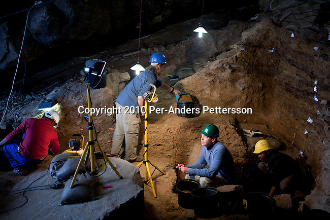 MOSSEL BAY, SOUTH AFRICA - MAY 26:  Dr. Curtis Marean (c) works with his colleagues inside a cave called PP13B on May 26, 2010, at Pinnacle Point near Mossel Bay South Africa. The cave sheltered humans between 164,000 and 35,000 years ago, at a time when Homo sapiens was in danger of dying out. These people may have been the ancestors of us. (Photo by Per-Anders Pettersson/Getty Images)