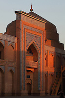 Low angle view of Museum of Applied Arts, Khiva, Uzbekistan, pictured on July 6, 2010, at sunset. The Museum of Applied Art and Life of Khorezm is a Madrasah, Kazi and Kalyan housing mainly 18th-19th century and some 20th century works by folk artists including jewellery, carpet weaving, pottery, wood and stone carving and copper coinage. Khiva, ancient and remote, is the most intact Silk Road city. Ichan Kala, its old town, was the first site in Uzbekistan to become a World Heritage Site(1991). Picture by Manuel Cohen.