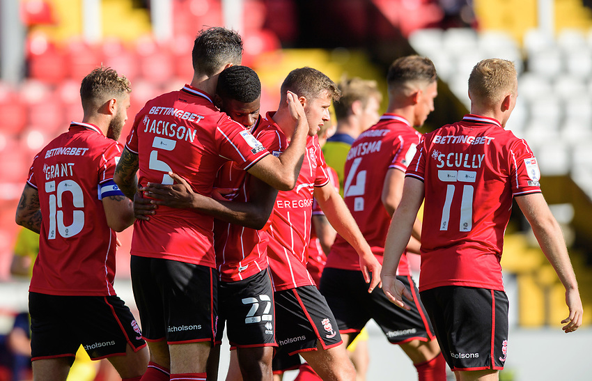 Lincoln City's Adam Jackson, left, celebrates scoring his side's second goal with team-mate Timothy Eyoma<br /> <br /> Photographer Chris Vaughan/CameraSport<br /> <br /> The EFL Sky Bet League One - Saturday 12th September 2020 - Lincoln City v Oxford United - LNER Stadium - Lincoln<br /> <br /> World Copyright © 2020 CameraSport. All rights reserved. 43 Linden Ave. Countesthorpe. Leicester. England. LE8 5PG - Tel: +44 (0) 116 277 4147 - admin@camerasport.com - www.camerasport.com - Lincoln City v Oxford United