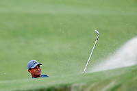 Tiger Woods (USA) hits out of a sand trap on the 16th hole during the first round of the 118th U.S. Open Championship at Shinnecock Hills Golf Club in Southampton, NY, USA. 14th June 2018.<br /> Picture: Golffile | Brian Spurlock<br /> <br /> <br /> All photo usage must carry mandatory copyright credit (&copy; Golffile | Brian Spurlock)
