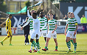 17th March 2019, Dens Park, Dundee, Scotland; Ladbrokes Premiership football, Dundee versus Celtic; Timothy Weah of Celtic swings his shirt over his head celebrating the win