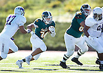 SPEARFISH, S.D. -- OCTOBER 1, 2016: Phydell Paris #34 of Black Hills State tries to elude New Mexico Highlands defender Xavier Hoover #47 during their game Saturday at Lyle Hare Stadium in Spearfish, S.D.  (Photo by Dick Carlson/Inertia)