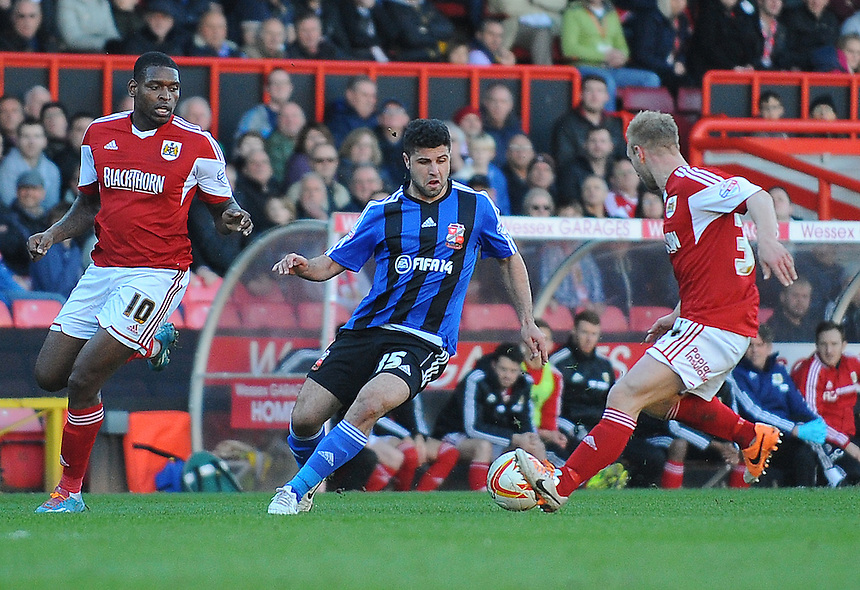 Swindon Town's Yaser Kasim under pressure from Bristol City's Simon Gillett<br /> <br /> Photo by Kevin Barnes/CameraSport<br /> <br /> Football - The Football League Sky Bet League One - Bristol City v Swindon Town - Saturday 15th March 2014 - Ashton Gate - Bristol<br /> <br /> &copy; CameraSport - 43 Linden Ave. Countesthorpe. Leicester. England. LE8 5PG - Tel: +44 (0) 116 277 4147 - admin@camerasport.com - www.camerasport.com