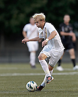 Boston College midfielder Kyle Bekker (10) dribbles. Brown University (black) defeated Boston College (white), 1-0, at Newton Campus Field, October 16, 2012.