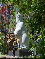BNPS.co.uk (01202 558833)<br /> Pic: PhilYeomans/BNPS<br /> <br /> Viewing artist Adam Binder's 'Boris the Polar Bear' - yours for £150,000, if you have a big garden.<br /> <br /> The ultimate garden sale...<br /> <br /> A bronze bust of Sir Winston Churchill leads an epic £5m sale of 400 garden sculptures an art fanatic is putting under the hammer.<br /> <br /> Eddie Powell turned 10 acres of unused land in the Surrey countryside into one of the world's largest sculpture parks 15 years ago.<br /> <br /> He crammed it with over 800 eye-catching pieces of art, ranging from a 19 tonne dragon made from 152,000 horse shoes to a 12ft tall bronze polar bear.<br /> <br /> Mr Powell is now down-sizing the collection and is selling half of the items in the park.