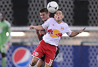 New York Red Bulls defender Connor Lade (16) heads the ball against D.C. United midfielder Perry Kitchen (23) The New York Red Bulls tied D.C. United 2-2 at RFK Stadium, Wednesday August 29, 2012.