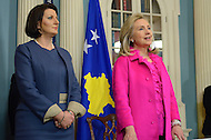 December 14, 2011  (Washington, DC)  After signing a cultural heritage preservation agreement at the Department of State, U.S. Secretary of State Hillary Clinton and the President of Kosovo, Atifete Jahjaga (left), answer questions from the press.    (Photo by Don Baxter/Media Images International)