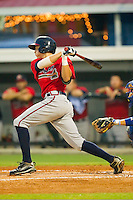 Nick Ahmed #22 of the Danville Braves follows through on his swing against the Burlington Royals at Burlington Athletic Park on August 12, 2011 in Burlington, North Carolina.  The Braves defeated the Royals 8-3.   (Brian Westerholt / Four Seam Images)