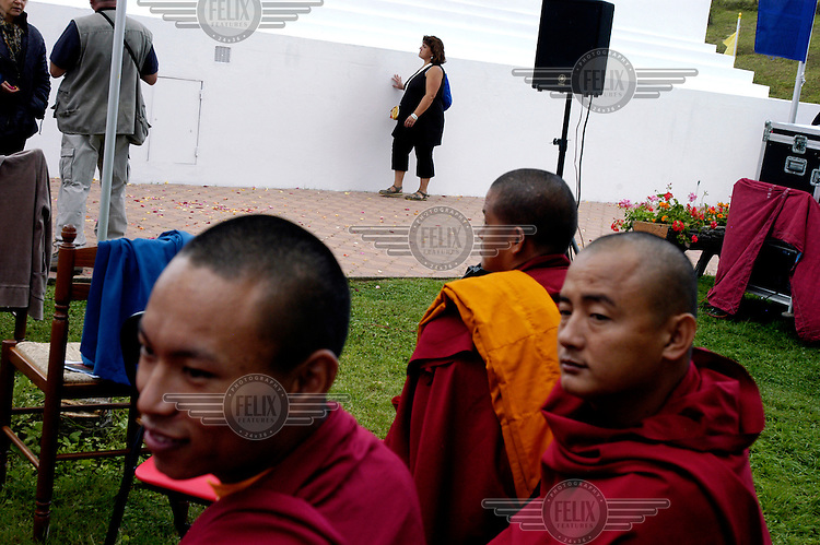 Buddhist monks and supporters gather following His Holiness the Dalai Lama's visit to the Vajradhara Ling Buddhist Temple during the visit of His Holiness to France. The Dalai Lama blessed a project to build a Temple for Peace at the centre and gave a speech to hundreds of guests.