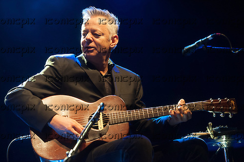 Tommy Emmanuel (Australian guitarist)  - performing live on 'The Colonel  And The Governor Tour 2013' at Shepherd's Bush Empire, London, England, UK - 16 Mar  2013.  Photo credit: Jeff Barclay/Music Pics Ltd/IconicPix