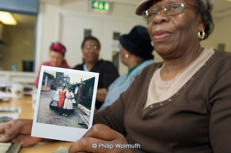 Catherine Harris, who worked at St.Mary's Hospital, Harrow Road, for 22 years, with a photograph of herself and a friend at the hospital in the early 1980's.  Open Age reminiscence session at the WECH Community Centre.