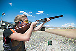 Alyssa Dunlap, 16 of Sonora Calif., poses with a $28,000 Beretta Gardone VT shotgun during the California Youth Shotgun Shooting Association's championship shootout at the Capitol City Gun Club in Carson City, Nev. on Saturday, May 2, 2015.<br /> Photo by Kevin Clifford/Nevada Photo Source