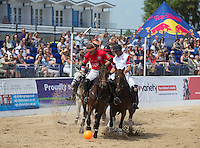 Rowdy Mathews of Wales attacks during the Wales v England match at the Asahi Beach Polo Championship  at Sandbanks, Poole, England on 10 July 2015. Photo by Andy Rowland.