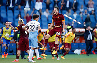 Calcio, Serie A: Lazio vs Roma. Roma, stadio Olimpico, 25 maggio 2015.<br /> Roma's Alessandro Florenzi celebrates past Lazio's Danilo Cataldi at the end of the Italian Serie A football match between Lazio and Roma at Rome's Olympic stadium, 25 May 2015. Roma won 2-1.<br /> UPDATE IMAGES PRESS/Riccardo De Luca