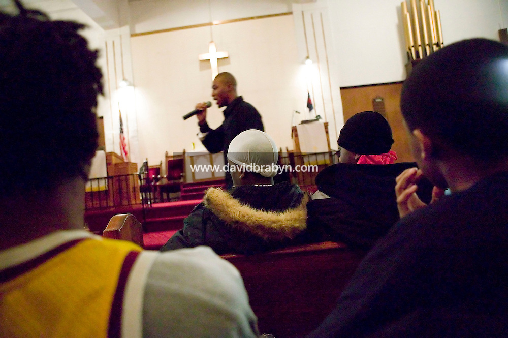 New York, USA - Lamar Hayney (C, background), 19, member of the Three Shades of Faith band, raps during mass at the Greater Hood Memorial AME Zion Church, home of the Hip-Hop Church, in Harlem, New York, USA, 20 January 2005. Photo Credit: David Brabyn.