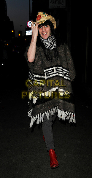 """NOEL FIELDING.Walking to the """"Nobby Clark Shoots Noel Fielding"""" private view, Maison Bertaux, Greek Street, London, England..April 22nd, 2008.full length jeans denim brown white poncho straw hat zebra print scarf red boots hand.CAP/CAN.©Can Nguyen/Capital Pictures."""