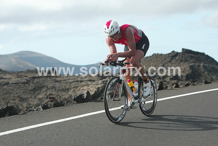 **ALL ROUND PICTURES FROM SOLARPIX.COM**.**WORLDWIDE SYNDICATION RIGHTS**.leading triathletes from around the world descended on the island of Lanzarote for the 2009 Iron Man competition - widely regarded as the toughest contest of its kind in the world. With over 1300 triathletes (the largest field yet) battling it out for the top prize of $50,000 and a coveted slot in the Iron Man Grand Final. Which is staged every year in Hawaii...This endurance event includes a 3.8km swim, followed by a 180km cycle ride. Topped off with a full 42.2km marathon. Lanzarote, Canary Islands, Spain. 23 May 2009..This pic: Ain Alar Juhanson..JOB REF: 9098 BFY        DATE: 23_05_2009.**MUST CREDIT SOLARPIX.COM OR DOUBLE FEE WILL BE CHARGED**.**ONLINE USAGE FEE GBP 50.00 PER PICTURE - NOTIFICATION OF USAGE TO PHOTO @ SOLARPIX.COM**.**CALL SOLARPIX : +34 952 811 768 or LOW RATE FROM UK 0844 617 7637**