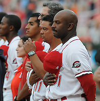 Manager Billy McMillon (51) of the Greenville Drive, Class A affiliate of the Boston Red Sox, listens to the National Anthem before a game against the Augusta GreenJackets on April 7, 2011, at Fluor Field at the West End in Greenville, S.C. Photo by Tom Priddy / Four Seam Images