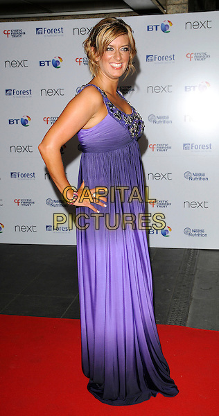 CAROLINE FERADAY .Cystic Fibrosis Breathing Life Awards 2009, Hilton London Metropole Hotel, London, England, UK, 28th May 2009..full length long maxi purple dress hands on hips beaded embellished .CAP/CAN.©Can Nguyen/Capital Pictures