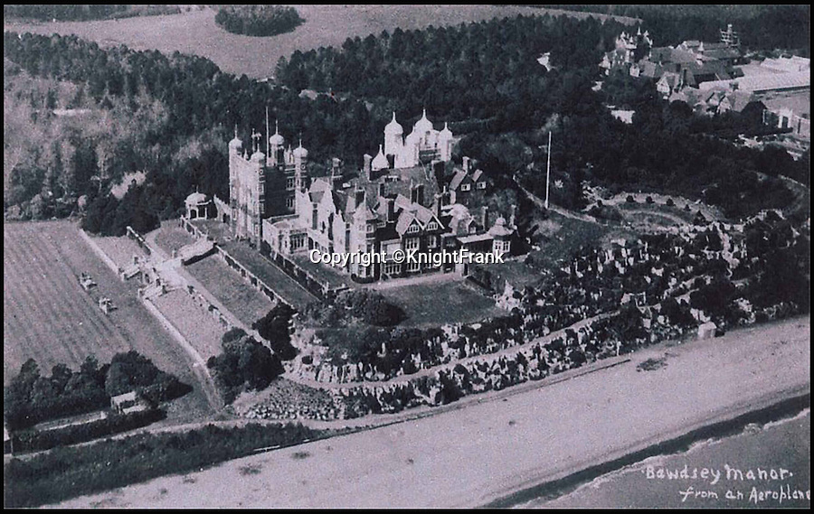 BNPS.co.uk (01202 558833)<br /> Pic: KnightFrank/BNPS<br /> <br /> Aerial view of Bawdsey Manor from the 1930's.<br /> <br /> Making waves - Seaside Suffolk mansion that was in the frontline of the battle to protect London and defeat the Luftwaffe during WW2 is on the market.<br /> <br /> A stunning Grade II* listed coastal manor house which was Britain's first radar station and survived multiple Luftwaffe attacks is now up for grabs.<br /> <br /> Bawdsey Manor is a home fit for royalty - a grand 144-acre estate on the Suffolk coast with a mansion that looks like the Queen's much-loved Sandringham House nearby.<br /> <br /> The impressive property, which also comes with quayside cottages and even has its own beach access, is on the market with estate agents Knight Frank with a guide price of £5million.