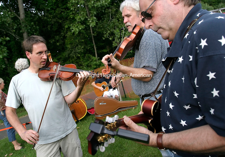 ROXBURY, CT, 08 July 2006- 070806BZ17- From left- Friso Hermans, Bridgewater, Howie Bujese, of Bethel, and Doug Spaulding, of New Fairfield, practice a song called &quot;Ashokan Farewell&quot; backstage at the 32nd annual Pickin 'N Fiddlin Contest in Roxbury Saturday. <br /> Jamison C. Bazinet Republican-American