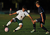 Marvin Contreras #4 of Westbury, left, gets pressured by Steven Betz #15 of Plainview JFK during a Nassau County Conference AA-3 boys soccer game at Westbury High School on Friday, Oct. 14, 2016. Plainview JFK won by a score of 1-0.