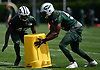 Brandon Bryant #40, left, and Obum Gwacham #57 of the New York Jets simulate coverage drills using a garbage can during Training Camp at the Atlantic Health Jets Training Center in Florham Park, NJ on Saturday, Aug. 18, 2018.
