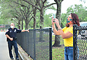 PEMBROKE PINES, FL - MAY 15: A parent takes a photo in the parking lot at Pembroke Pines Charter High School on May 15, 2020 in Pembroke Pines, Florida. Because of social distancing mandates instituted by the state to curtail the spread of COVID-19, the 2020 graduates received their diplomas in a near-empty auditorium with no friends, family or relatives allowed to attend. A video of each student walking the stage to receive their diploma will be streamed on the school's scheduled graduation date of May 29.   ( Photo by Johnny Louis / jlnphotography.com )
