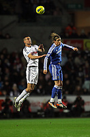 Pictured L-R: Battling for a header Steven Caulker of Swansea against Fernando Torres of Chelsea. Tuesday, 31 January 2012<br />