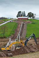 Pipeline near farm pond. Susquehanna County, Marcellus Shale, Pennsylvania.