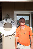 EXUMA, Bahamas. Yves, the Manager at Fowl Cay Resort standing by the resort office.