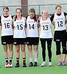 FRANKFURT AM MAIN, GERMANY - April 14: ?16#, Colleen O'Connor #15 of Germany, Lisa Neubert #14 of Germany, Katharina Schroer #13 of Germany and Eva Schulte #12 of Germany during the national anthem before the Deutschland Lacrosse International Tournament match between Germany vs Great Britain during the on April 14, 2013 in Frankfurt am Main, Germany. Great Britain won, 10-9. (Photo by Dirk Markgraf)