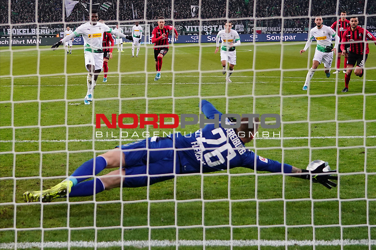 01.12.2019, Borussia Park , Moenchengladbach, GER, 1. FBL,  Borussia Moenchengladbach vs. SC Freiburg,<br />  <br /> DFL regulations prohibit any use of photographs as image sequences and/or quasi-video<br /> <br /> im Bild / picture shows: <br /> 11 Meter durch Breel Embolo (Gladbach #36),  haelt Mark Flekken Torwart (Freiburg #26), <br /> <br /> Foto © nordphoto / Meuter