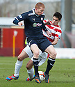 Raith's Jason Thomson and Accies Stephen Hendrie challenge for the ball.