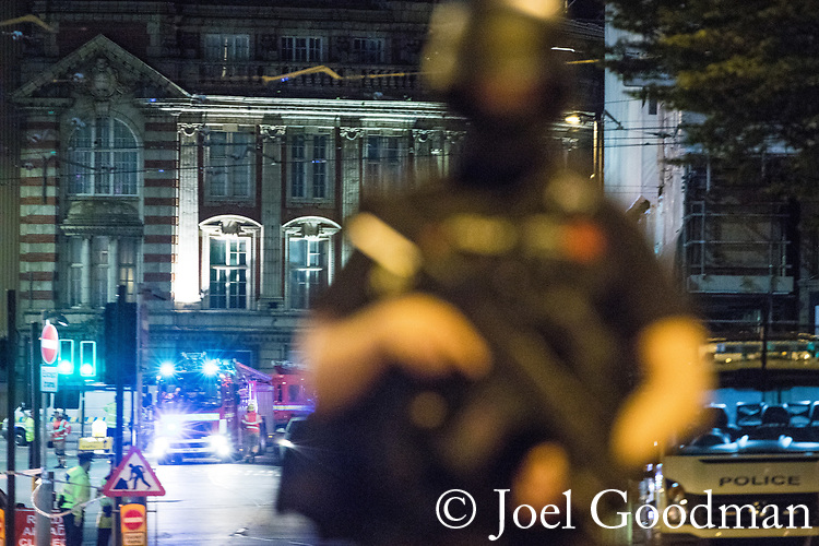 © Joel Goodman - 07973 332324 . 23/05/2017. Manchester, UK. Police and other emergency services are seen near the Manchester Arena after reports of an explosion. Police have confirmed they are responding to an incident during an Ariana Grande concert at the venue. Photo credit : Joel Goodman