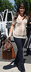 September 16th 2010  Exclusive .Filming the tv show Chuck in Los Angeles. Acne.Sarah Lancaster carrying a brown leather purse while also carrying a lighter brown Indian bag. Sarah was smiling as she walked to set showing off her new brown hair. It looks like she might have a little baby bump. Could Sarah be pregnant? They were also filming the show inside of a baby store..AbilityFilms@yahoo.com.805-427-3519.www.AbilityFilms.com..