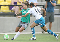Lauren Cheney #11 of Abby's XI  gets ready to crosso ver the ball past Brittany Taylor #14 of Marta's XI during the WPS All-Star game at KSU Stadium in Kennesaw, Georgia on June 30 2010. Marta XI won 5-2.
