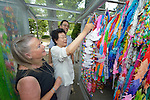 Three members of a World Council of Churches delegation hang folded paper cranes in Hiroshima, Japan, on August 7, 2015. The pilgrims, who come from around the world, folded a thousand paper cranes to leave at the site, where every year Japanese school children leave millions of the origami birds as a demonstration of their commitment to a world without nuclear weapons. The delegation members came to Japan to see for themselves, to listen to survivors and local church leaders, and to recommit themselves to new forms of advocacy for a world free of nuclear weapons.