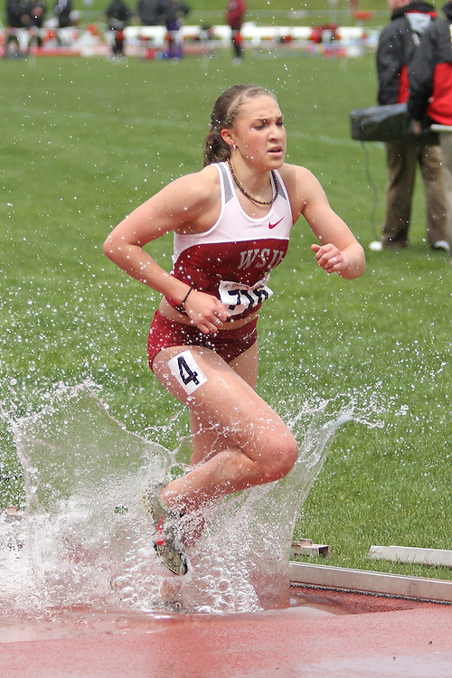 Caroline Austin, Washington State freshman, splashes out of the water pit on the way to victory in the 3000 meter steeplechase during the Cougars dual track and field meet with arch-rival Washington at Mooberry Track at Washington State University in Pullman, Washington, on May 1, 2010.