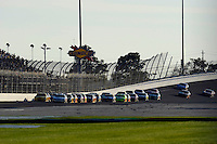 The field races out of turn 2 and onto the back straight led by Clint Bowyer (#33) and Kasey Kahne (#9).
